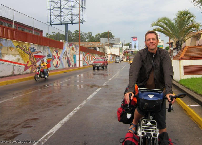 Kai cycling in the rain in Tepic