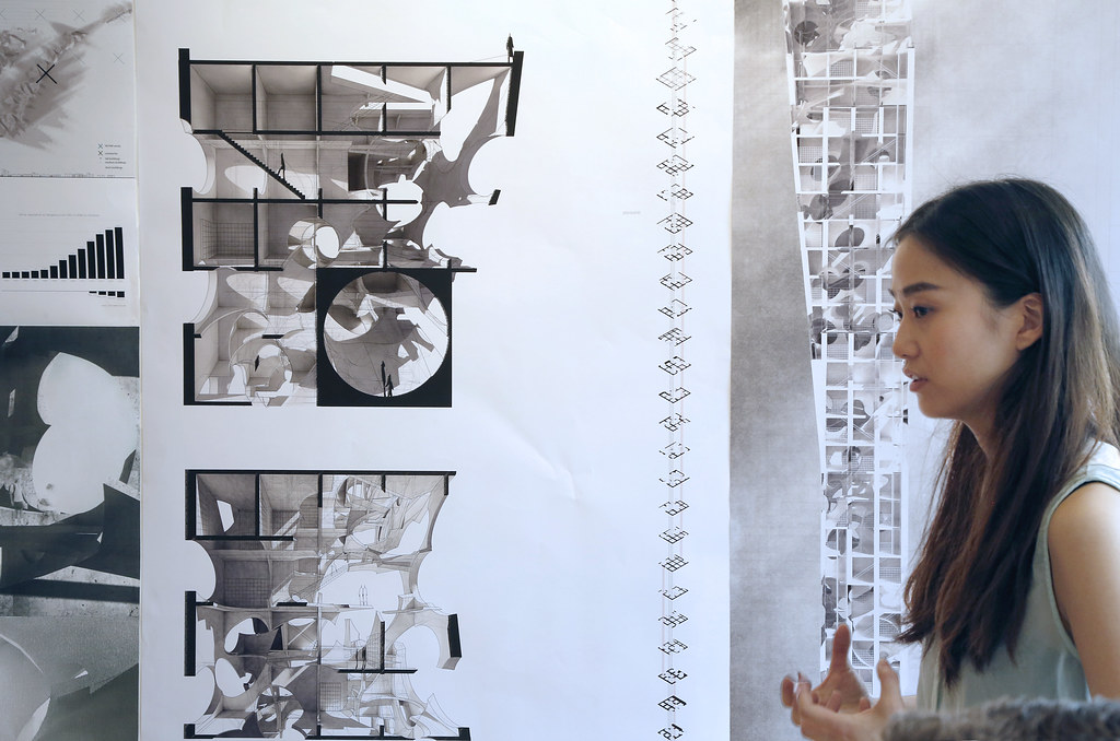 Lisa Zhu presenting her work in the College of Architecture, Art, and Planning's John Hartell Gallery.