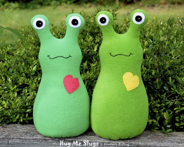 Kelly green and grass green Hug Me Slugs, original art toys by Elizabeth Ruffing