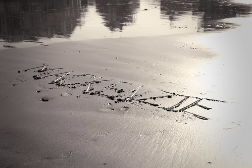 Written in the sand  by Ali Crehan