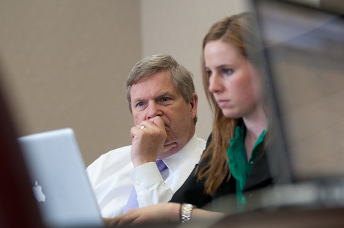 "Agriculture Secretary Tom Vilsack responds to questions, with the assistance of Office of Communications Director of Web Communications Amanda Eamich, during the first Virtual Office hours live ""Twitter"" session held at the U.S. Department of Agriculture in Washington, D.C., on Thursday, April 4, 2012. USDA photo by Lance Cheung."