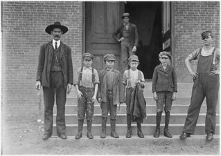 Boy with coat in hand is 11 years old. Been there 9 months, November 1908