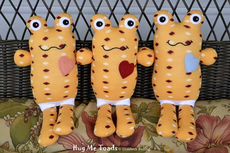Orange Hug Me Sock Toads with polka dots, original art toy by Elizabeth Ruffing