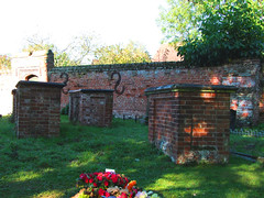 brick tombchests and the wall of Rayne Hall