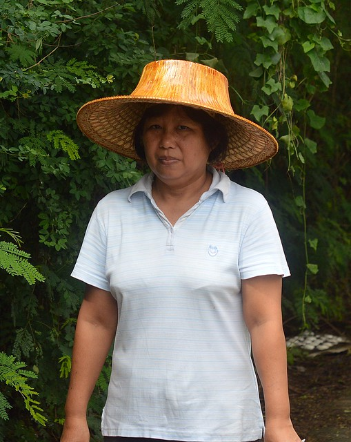 woman wearing new palm leaf hat