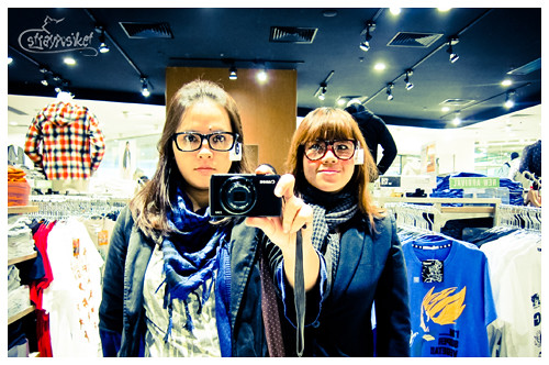 trying out the specs at uniqlo