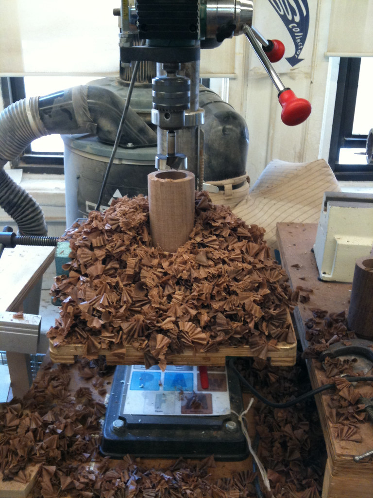 Wood being drilled on the drillpress
