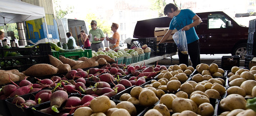 The Baltimore Farmers Market helps meet America's demand for local and regional food. Farmers markets, farmers auctions, and direct to consumer reports are now being produced by USDA Market News. The reports are available for businesses of all size to help level the playing field in the $7 billion a year local and regional food market. USDA Photo Courtesy of Lance Cheung.