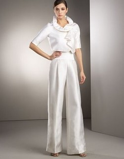 a woman in a white pants suit