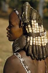 Angola. A Mwila mother wears her hair in thick, beaded locks.  Humpata // ©Volkmar K Wentzel