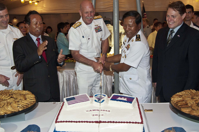 A Cake Cutting Ceremony At A Reception Held Aboard Blue