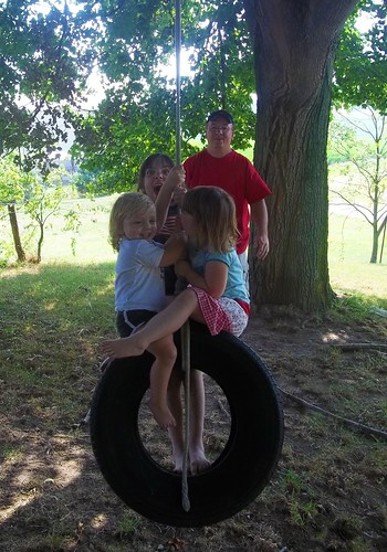 All three girls on the tire swing