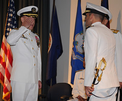 Capt. Brian Howes turns over command of Submarine Development Squadron (SUBDEVRON) 5 to Capt. Jeffrey Jablon during a ceremony at the Naval Undersea Museum in Keyport, Wash., Aug. 10. (U.S. Navy photo by Mass Communication Specialist 1st Class Ahron Arendes)
