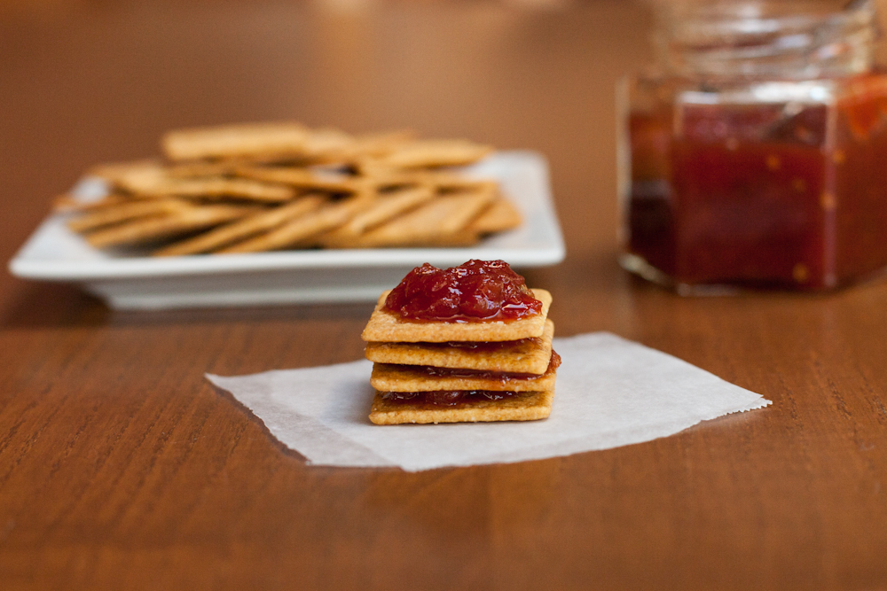 Tomato jam and crackers piled high so you can eat them one after another