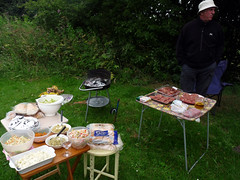 barbecue(0.0), meal(1.0), outdoor grill(1.0), grilling(1.0), outdoor recreation(1.0), meat(1.0), food(1.0), cuisine(1.0), picnic(1.0),