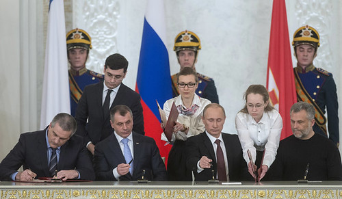 Russian President Putin signs treaty with Prime Minister Sergey Aksyonov merging Crimea and Moscow. Crimeans voted overwhelmingly to join Russia. by Pan-African News Wire File Photos