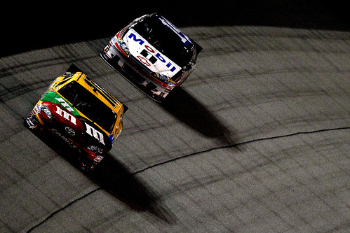 Kyle Busch, driver of the #18 M&M's Ms. Brown Toyota, leads Tony Stewart, driver of the #14 Mobil 1/Office Depot Chevrolet, during the NASCAR Sprint Cup Series Capital City 400 at Richmond International Raceway on April 28, 2012 in Richmond, Virginia