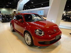 automobile(1.0), volkswagen beetle(1.0), automotive exterior(1.0), exhibition(1.0), wheel(1.0), volkswagen(1.0), vehicle(1.0), automotive design(1.0), volkswagen new beetle(1.0), auto show(1.0), subcompact car(1.0), city car(1.0), land vehicle(1.0), luxury vehicle(1.0), motor vehicle(1.0),