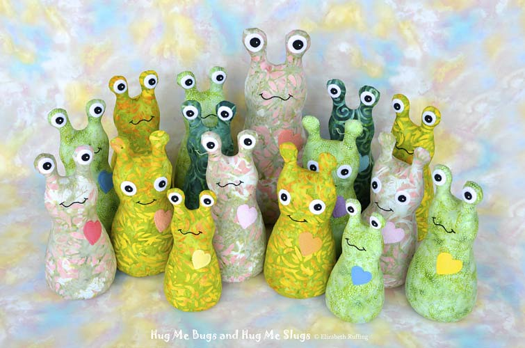 Green batik Hug Me Bugs and Hug Me Slugs, original art toy by Elizabeth Ruffing