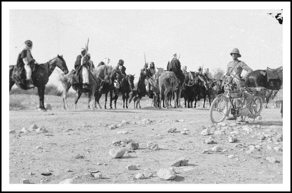 British Army officer ( with motorcycle ) and bedouin in Amman, TransJordan - circa April 1921
