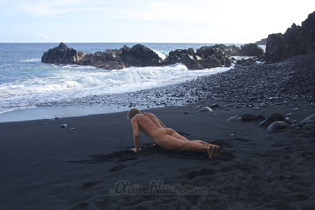 naturist yoga 0002 Kehena black sand beach, Hawaii, USA