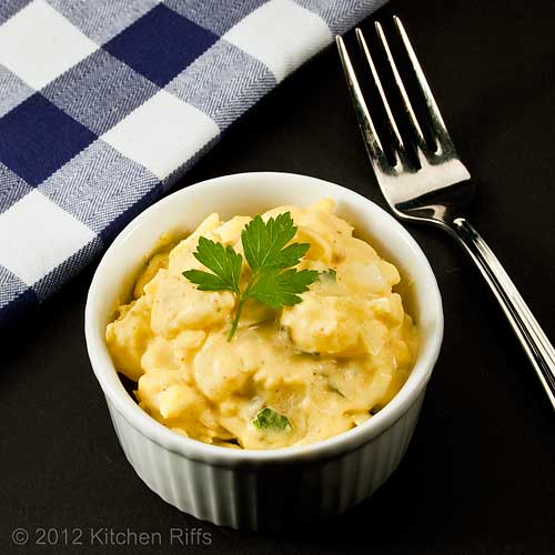 Mustard Potato Salad in White Ramkein with Parsley Garnish, Black Background
