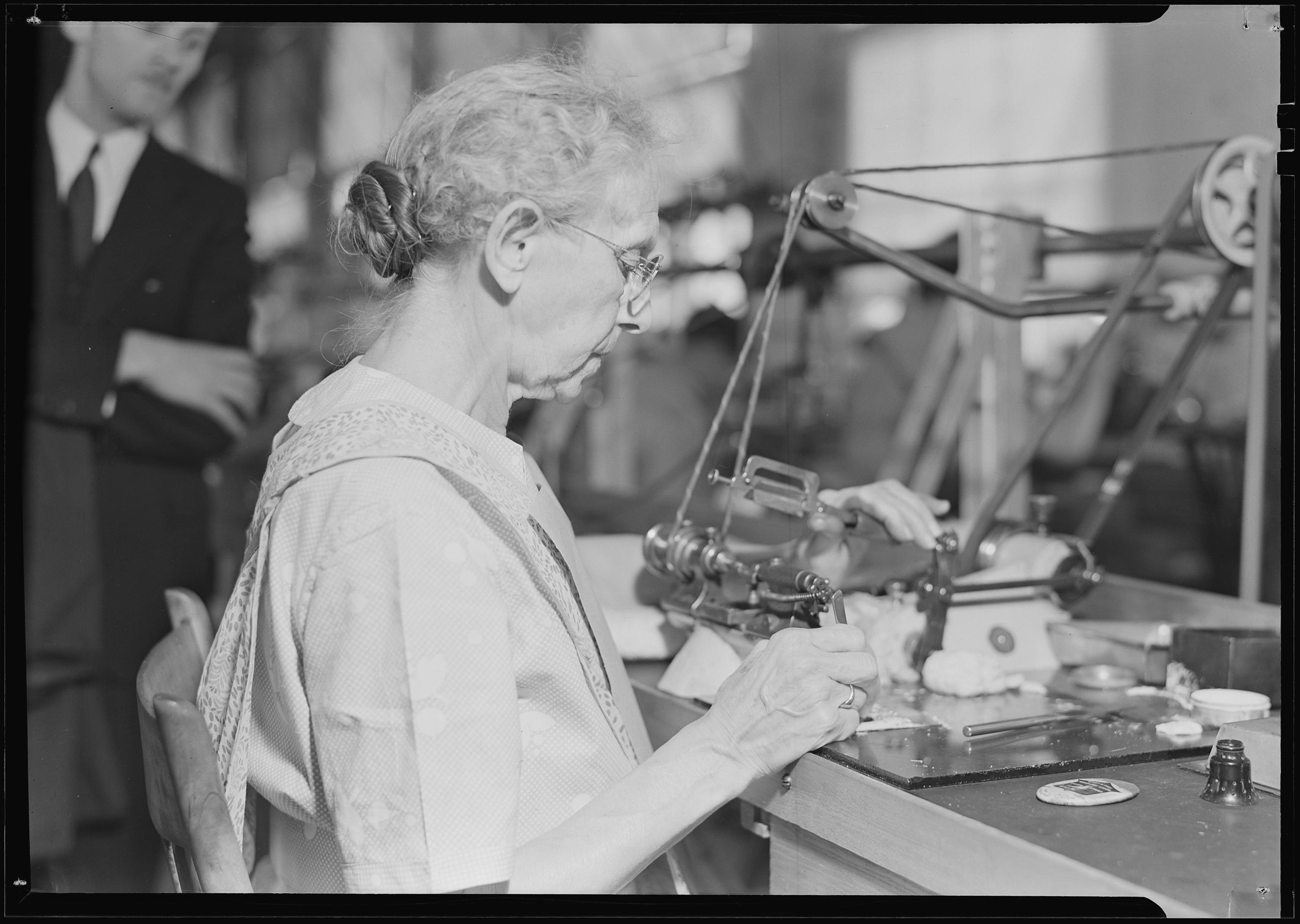 Hamilton Watch. Operation - polishing machine - machine is called wig-wag machine and is used to polish pivots and staff shoulders - semi-skilled operation, 1936