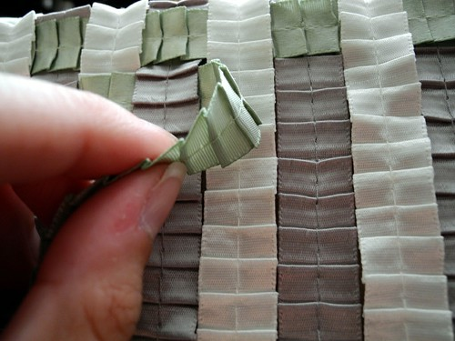 Weave the cross strips into the adhered strips
