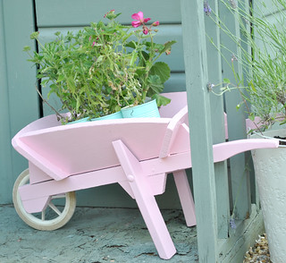 Flower filled kids pink wheelbarrow