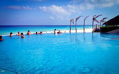 bay(0.0), swimming pool(1.0), beach(1.0), sea(1.0), ocean(1.0), leisure(1.0), vacation(1.0), resort(1.0), caribbean(1.0),