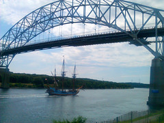 The Kalmar Nyckel beneath the Sagamore Bridge. The ship is actually <i>fifty years newer</i> than the bridge!