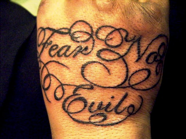 Script lettering with swirls on hand tattoo flickr for Letter tattoos on hand