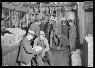 E. H. Elam, interviewer for the TVA, making personal interviews at Stiner's Store, Lead Mine Bend, Tennessee, with applicants for work on Norris Dam, November 1933