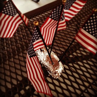 Yes, that's a #potato holding those #americanflags. Happy #fourthofjuly everyone. #independence day.