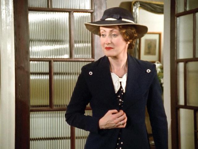 Poirot_MsLemon_VeiledLady_navycoatbuttonsshoulder