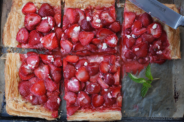Strawberry goat cheese tart with a slice missing