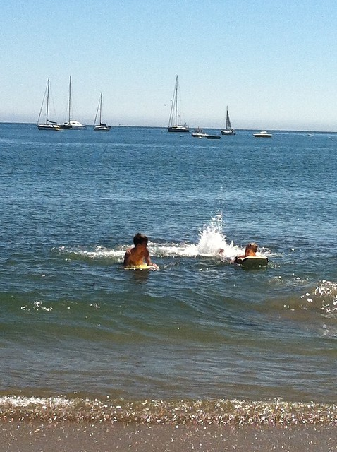 Kids boogie boarding in the Pacific