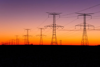 Recession (January 2013 Desktop Background) - Silhouette of power lines against a sunset