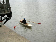 canoeing(0.0), boats and boating--equipment and supplies(1.0), vehicle(1.0), rowing(1.0), skiff(1.0), watercraft rowing(1.0), boating(1.0), oar(1.0), boat(1.0), paddle(1.0),
