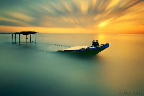 longexposure morning light sea sky bali cloud sun mist seascape reflection beach water clouds sunrise canon indonesia landscape photography eos golden scenery colorful aqua asia exposure ship glow waterfront view air explorer explore filter shore 7d nd usm dslr noise filters polarizer 1022mm hitech sanur waterscape contras colourfull canonefs1022mmf3545usm nd400 polarize f3545 beautifulbali canon7d pantaimatahariterbit manbutur manbuturphotography