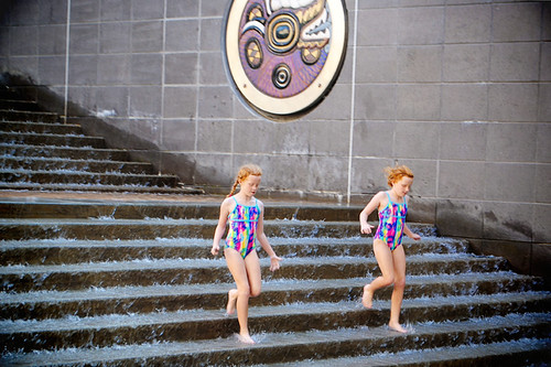Girls running down water stairs 72
