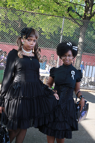 two fans dressed in black at the festival