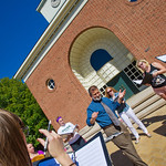 12-053 -- Professor of Music Scott Ferguson leads a choral rehearsal outdoors in the fine fall weather.