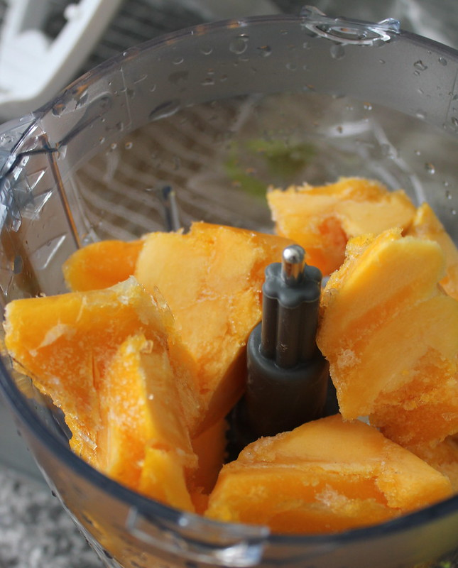 Chunks of mango gelato in blender