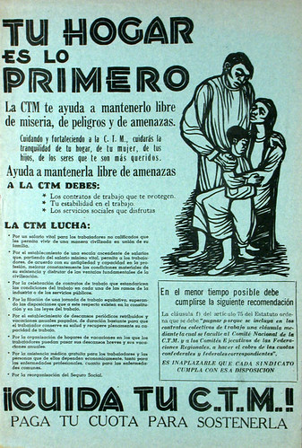 A blue poster reading Tu Hogar es lo Primero, with a woodcut of family of three pictured. The rest of the poster is text in Spanish.