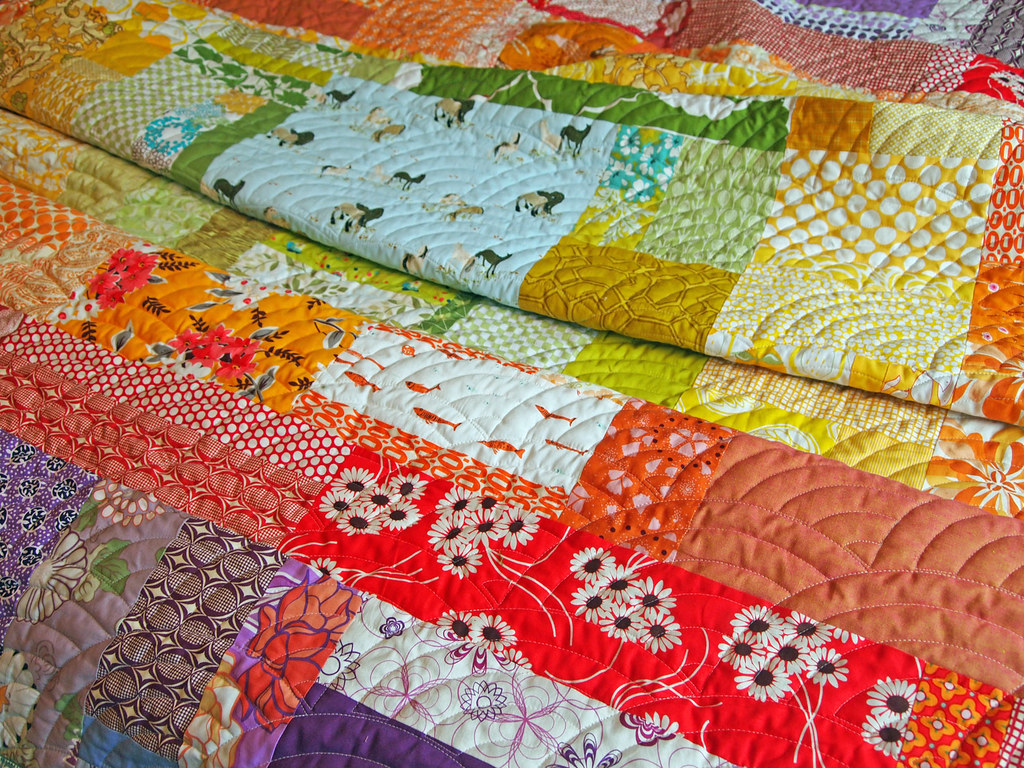 Claire's rainbow log cabin quilt