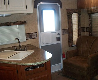 rv exterior door between sink & chair