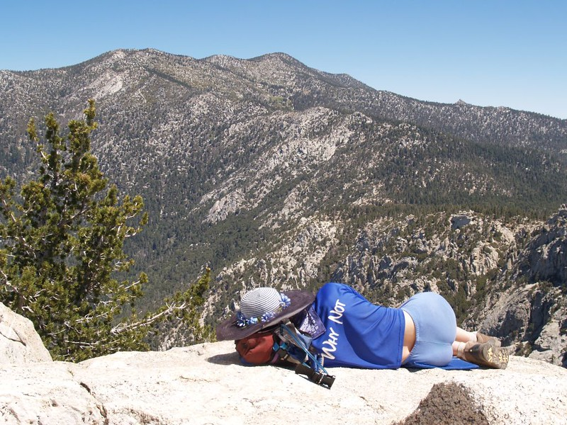Taking a nap on Tahquitz Peak with Marion Peak, Jean Peak, Miller Peak, and Cornell Peak