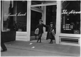 Max Schwartz, 8 years old, and Jacob Schwartz, sells until 10 P.M. sometimes. Newark, N.J., December 1909