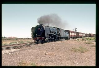 047.  1980-12. Goods train leaving De Aar.  Class 25NC 3522 ELBE - South African Railways.